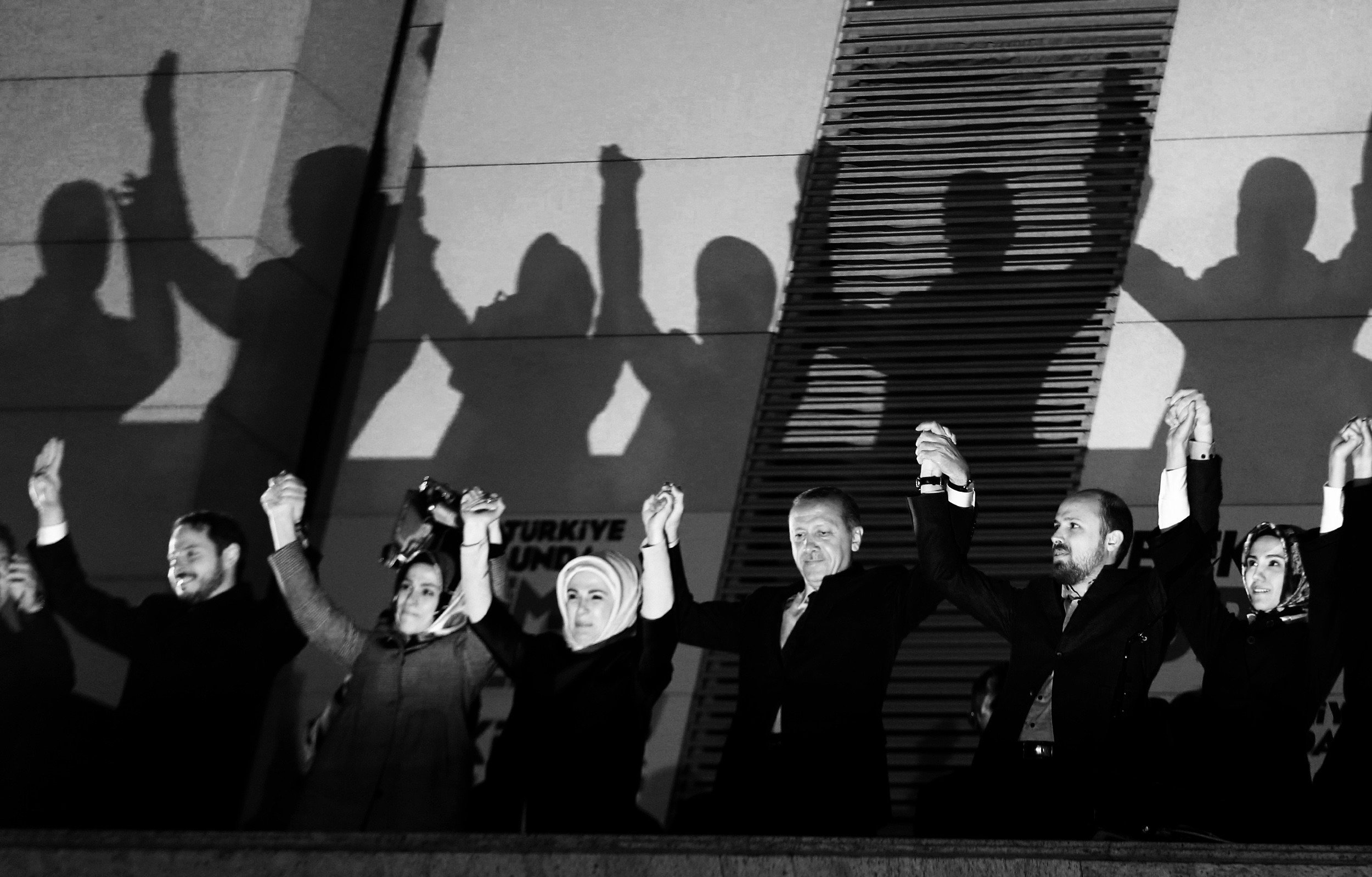 "Turkey's Prime Minister Tayyip Erdogan (3rd R) greets his supporters with his family members in Ankara March 31, 2014. Tayyip Erdogan's ruling AKP party appeared on Sunday to be heading for a clear victory in local polls that have become a referendum on a prime minister facing corruption scandals and security leaks he blames on ""traitors"" embedded in state bodies. Erdogan's family members from L to R are his son-in-law Berat Albayrak, his daughter Esra Erdogan Albayrak, his wife Emine, his son Bilal and his daughter Sumeyye. REUTERS/Umit Bektas (TURKEY - Tags: POLITICS ELECTIONS TPX IMAGES OF THE DAY)"